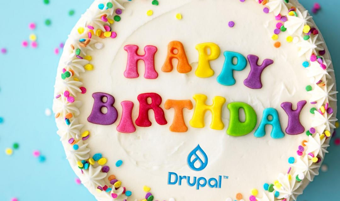 "Birthday cake with ""happy birthday"" written on the top and a Drupal logo"