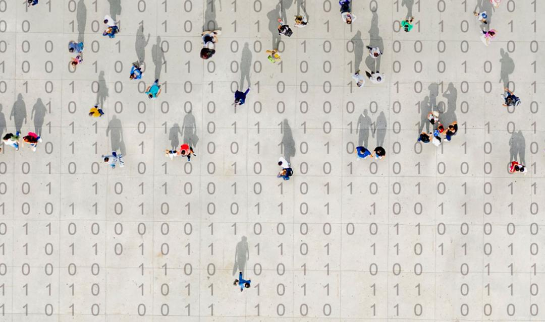 small people moving across a background of computer binary numbers