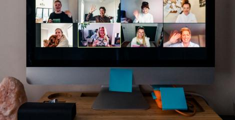 conducting group video chat on home office computer