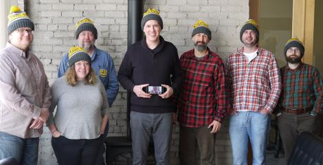 members of Electric Citizen, all wearing team hats