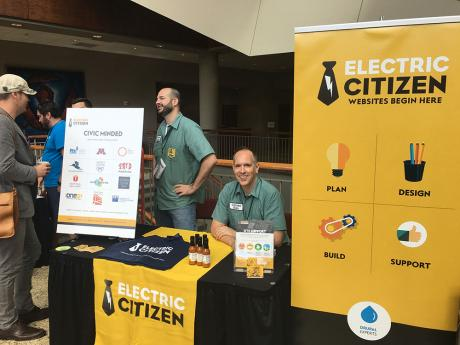 Dan at the Electric Citizen booth during a conference