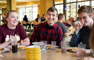students hanging out together in a dining hall