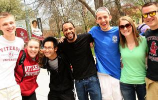 Group of Viterbo students smiling together on campus
