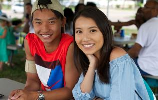 young adult asian american couple at an outdoor picnic